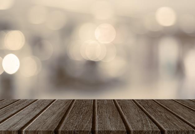 Pusty perspektywa drewna deski stołowy wierzchołek z abstrakcjonistycznym bokeh światła tłem dla montażu twój produkt.