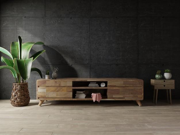Pusty pokój na poddaszu z szafką na telewizor na ciemnym betonowym wnętrzu background.3d rendering