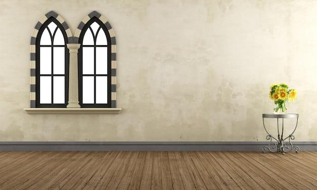 Pusty pokój retro z gotyckimi oknami i stolikiem kawowym ze słonecznikami. renderowanie 3d