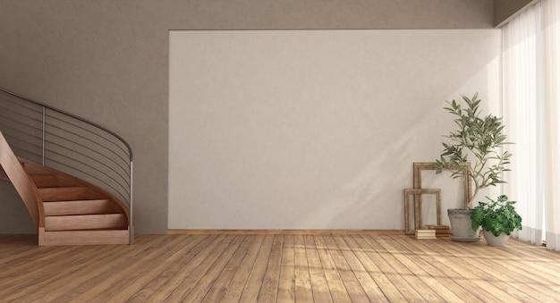 Pusty pokój z drewnianymi schodami i drewnianą podłogą