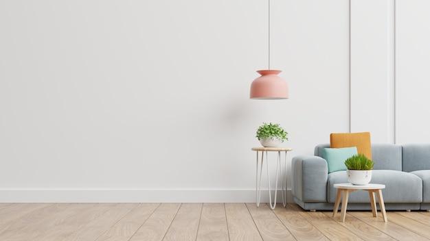 Pusty salon z niebieską sofą, roślinami i stołem na tle pustej białej ściany. renderowanie 3d