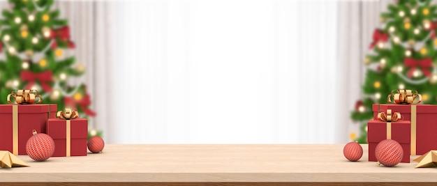 Pusty stół z drewna ozdobiony pudełkami na prezenty i bombkami