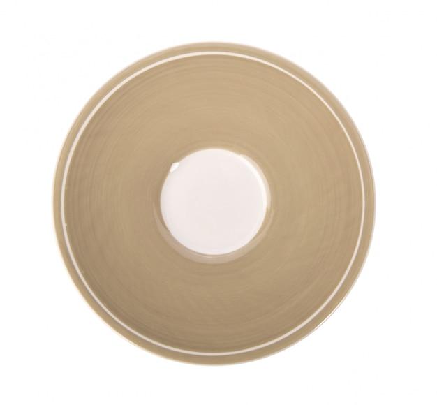 Pusty talerz na białej powierzchni