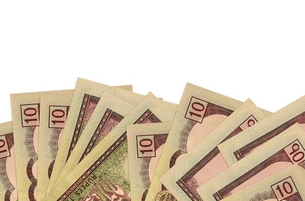 Rachunki 10 rupii nepalskich znajdują się w dolnej części ekranu na białej ścianie z miejscem na kopię.