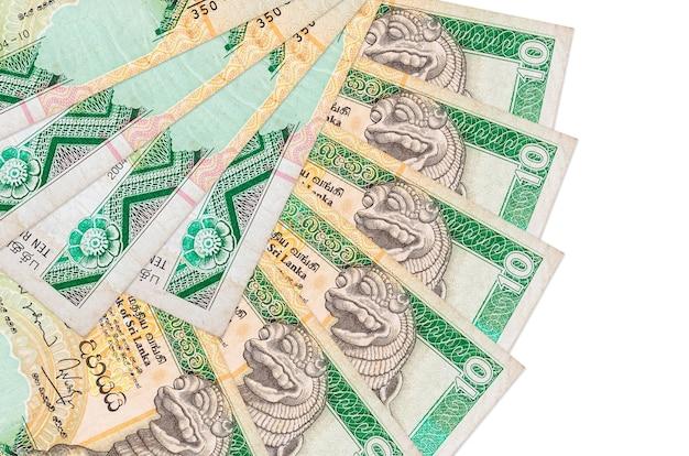 Rachunki 10 rupii sri lanki leży na białym tle z miejsca kopiowania ułożone w kształcie wentylatora z bliska