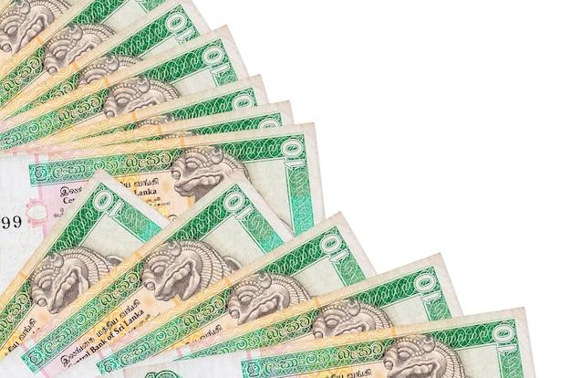 Rachunki 10 rupii sri lanki leży na białym tle z miejsca kopiowania ułożone w wentylator z bliska