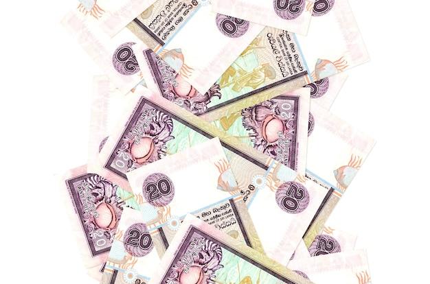 Rachunki 20 rupii lankijskich pływające w dół na białym tle. wiele banknotów spada z białymi miejscami na kopię po lewej i prawej stronie