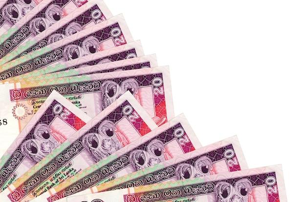 Rachunki rupii lankijskich leży na białym tle