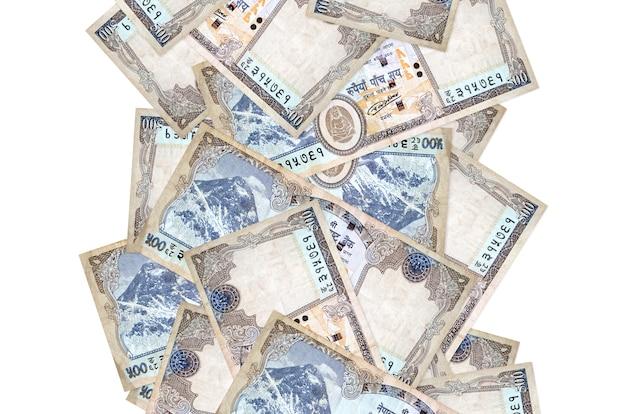 Rachunki rupii nepalskich pływające w dół na białym tle