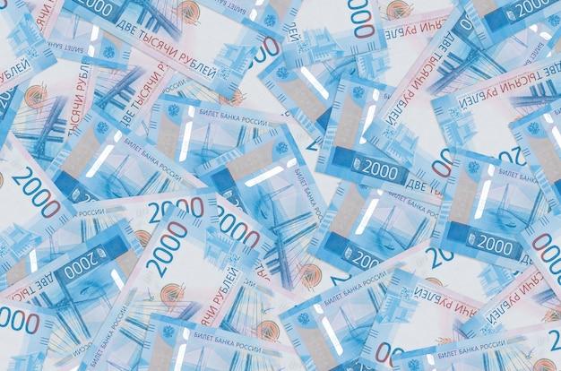Rachunki za 2000 rubli rosyjskich leżą na stosie. . dużo pieniędzy