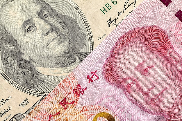 Rachunku dolara amerykańskiego i banknotu juan yuan makro