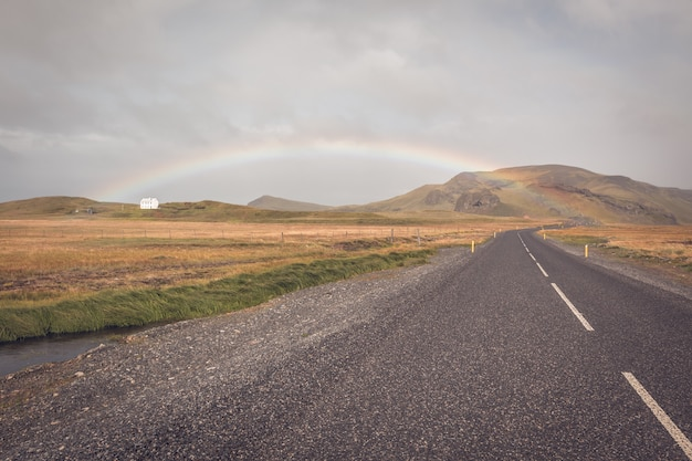 Rainbow and endless icelandic highway