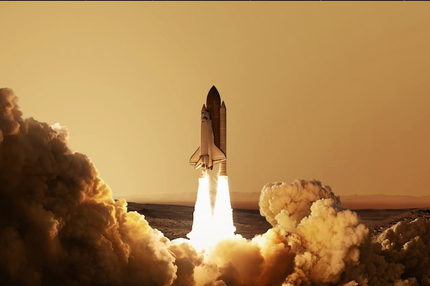 Rakieta startuje na czerwonej planecie mars. ponowne uruchomienie statku kosmicznego. kosmiczna tapeta
