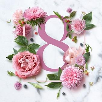 Rama kwiatów i numer 8 na białym tle. kartka z życzeniami na 8 marca, mieszkanie leżące