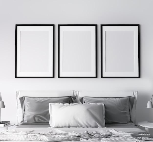 Rama w nowoczesnym designie sypialni, trzy czarne ramki na jasnej białej ścianie