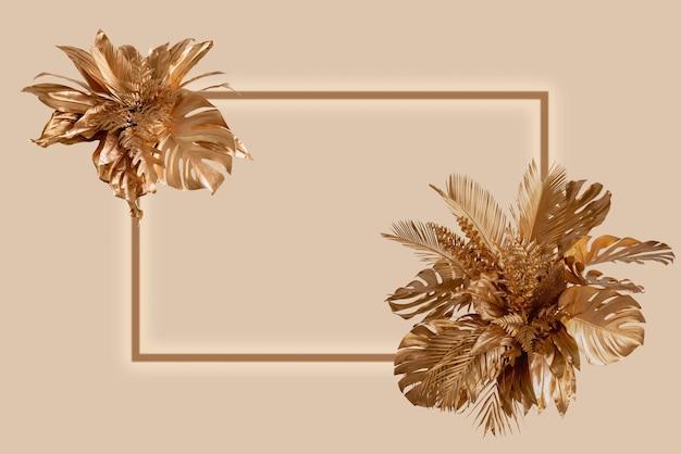 Rama z grupą złotych tropikalnych liści storczyków liści palmowych i monteli w stylu boho na białym tle