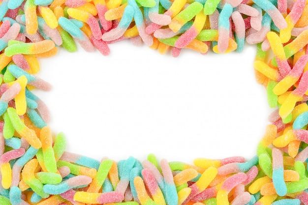 Ramka na białym tle kolorowe żelki cukierki