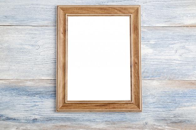 Ramka na zdjęcia na drewnianym tle - obraz efekt stylu vintage