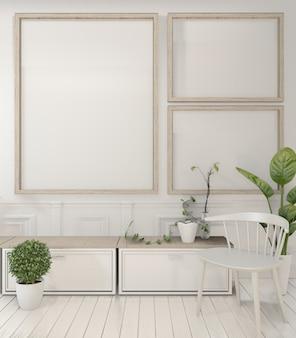 Ramka plakatowa oraz rośliny i elementy dekoracyjne na minimalistycznym wystroju w białym pokoju.