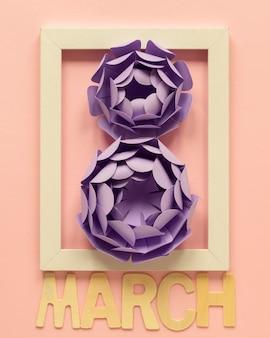 Ramka z papierowymi kwiatami i miesiącem na dzień kobiet