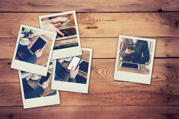 Ramowa fotografii kobieta używa telefon i pastylka set w sklep z kawą pojęciu na stołowym drewnianym tle. rocznik filtrowany.