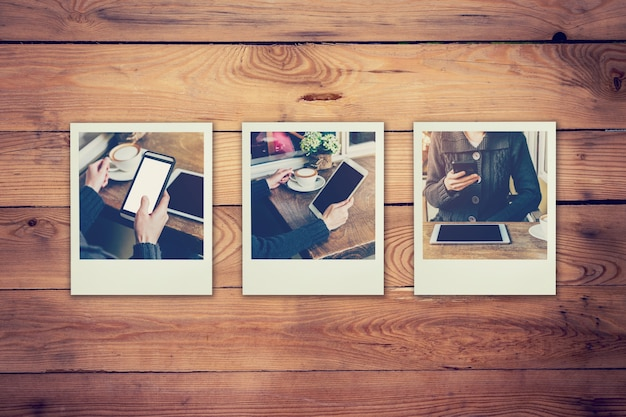 Ramowe fotografie kobieta używa telefon i pastylka set w sklep z kawą pojęciu na stołowym drewnianym tle. rocznik filtrowany.
