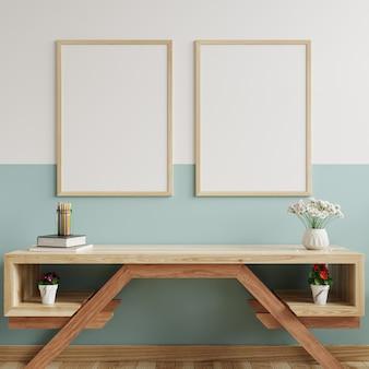 Ramy do zdjęć na ścianie w salonie, ozdobione stolikiem rtv i doniczkami