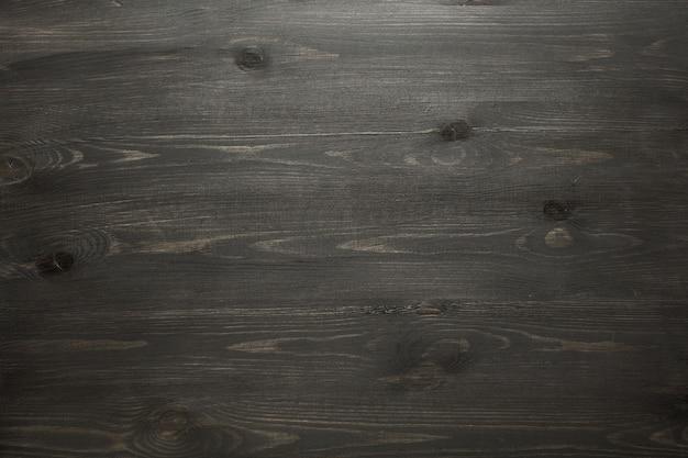 Realistyczna czarna drewniana tekstura.