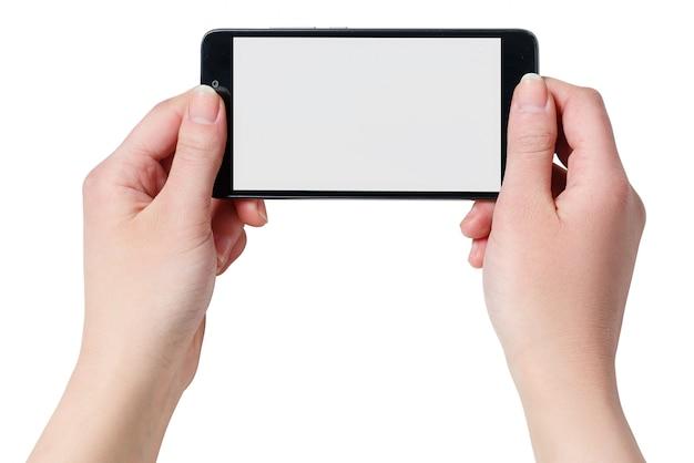 Ręce, trzymając czarny smartfon z pustego ekranu