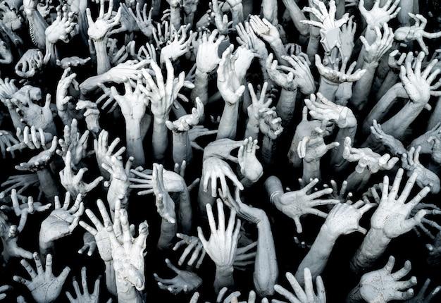 Ręce z piekła rodem - tło z przerażeniem zombie breakout.