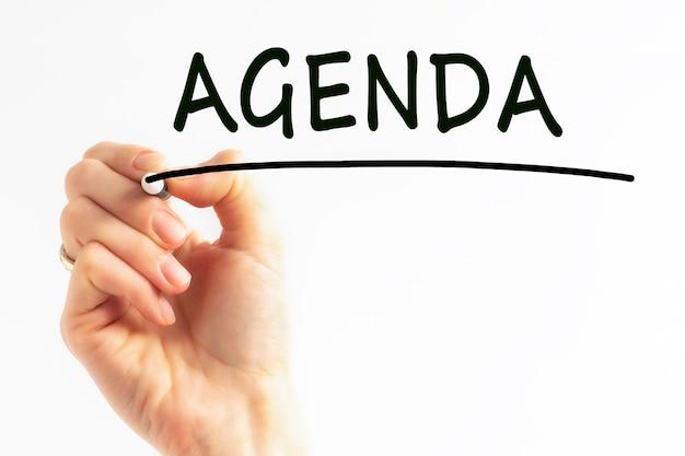 Ręczne pisanie agendy napis z czarnym markerem, koncepcja, obraz pień