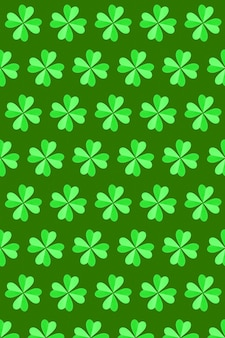 Ręcznie robiony wzór zielonych roślin koniczyny z czterema płatkami wykonanymi z papieru na zielonej ścianie. koncepcja happy st patrick's day.