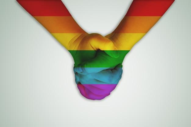 Ręcznie rysowane jak tęczowa flaga na szarym tle. tematy lgbt, lesbijki, geje, osoby transpłciowe, biseksualne. symbol nietradycyjnych mniejszości.