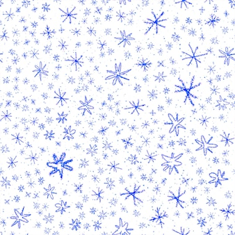 Ręcznie rysowane płatki śniegu boże narodzenie bezszwowe wzór. subtelne latające płatki śniegu na tle płatki śniegu kredą. kusząca nakładka śnieżna handdrawn kreda. kreatywna dekoracja sezonu wakacyjnego.