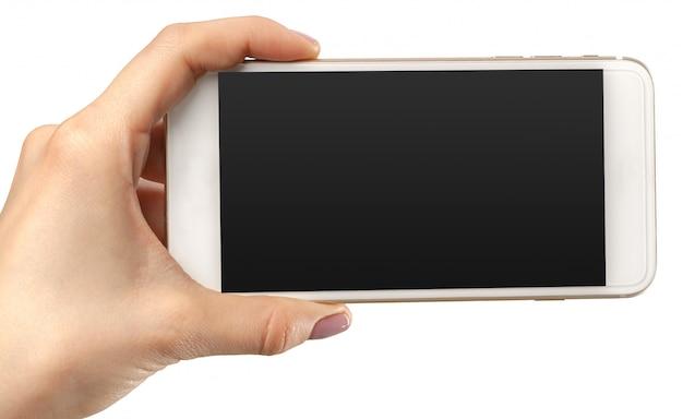 Ręka chwyta smartphone wisząca ozdoba odizolowywająca