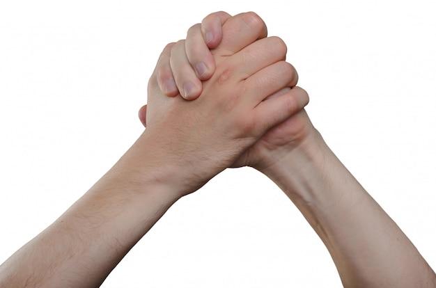 Ręka dorosłego mężczyzny. gest dłoni - uścisk dłoni dwóch rąk nad głową, znak zwycięstwa, znak szczęścia