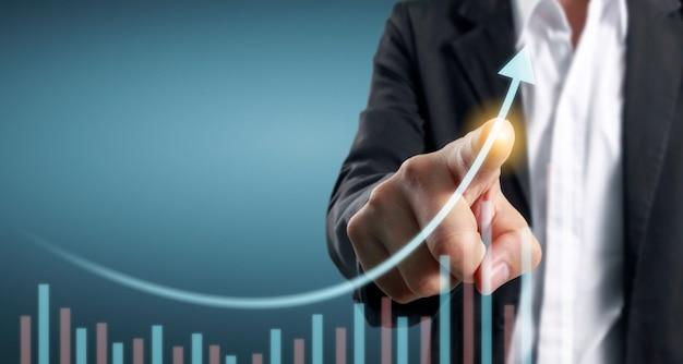 Ręka dotykając wykresy wskaźnika finansowego i wykresu analizy gospodarki rynkowej rachunkowości