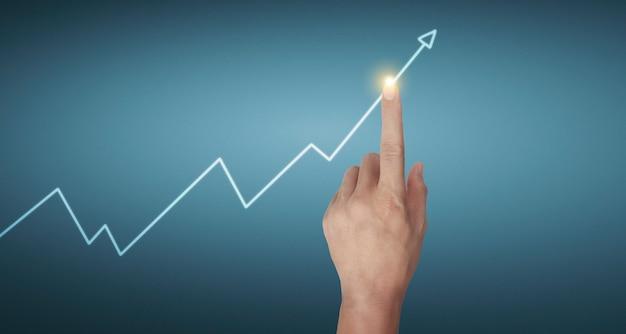 Ręka dotykająca wykresów wskaźnika finansowego i wykresu analizy gospodarki rynkowej rachunkowości