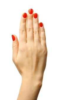 Ręka kobiety dokonywanie znak na białym tle