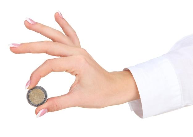 Ręka kobiety z monetą euro, na białym tle