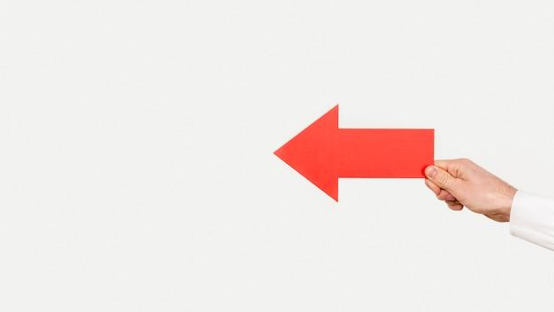 Ręka miejsca kopiowania z czerwoną strzałką
