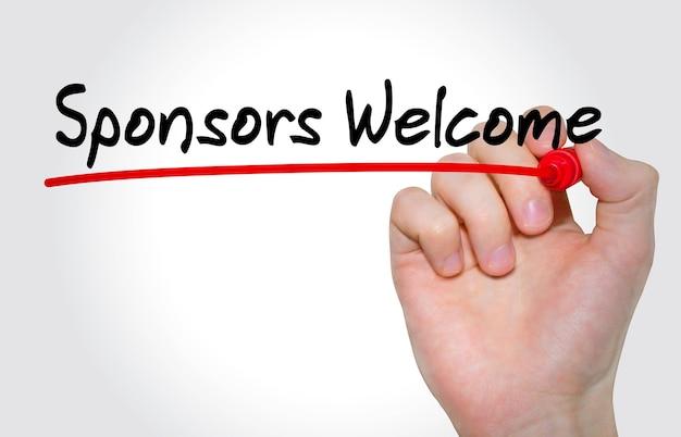 Ręka pisze napis sponsorzy witamy z markerem, koncepcja