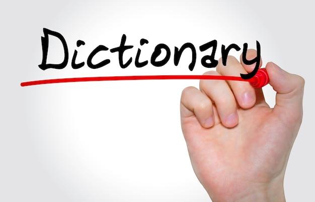 Ręka pisze słownik napis z markerem