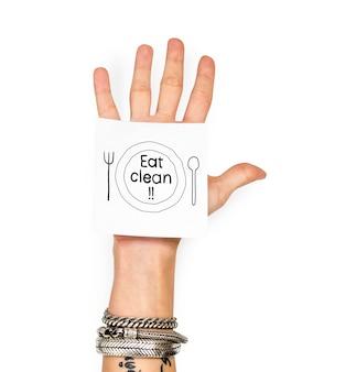 Ręka pokazuje kleistą notatkę z jedzą czystego