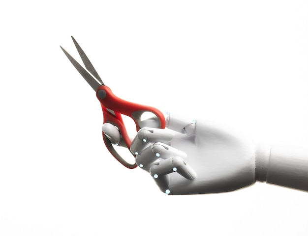 Ręka robota trzyma parę nożyczek na białym tle