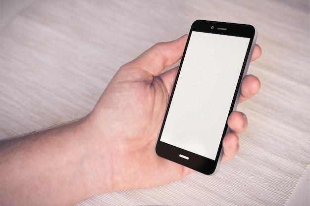 Ręka smartphone makieta