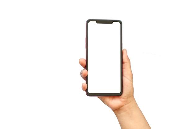 Ręka trzyma biały ekran, telefon komórkowy jest izolowany na białym tle ze ścieżką przycinającą.