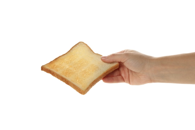 Ręka trzyma chleb tostowy na białym tle