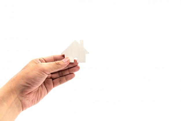 Ręka trzyma ikonę białego domu