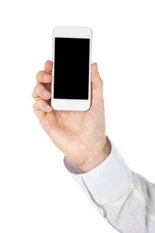Ręka trzyma inteligentny telefon komórkowy na białym tle